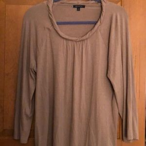 3/4 sleeve jersey with a rope trim neckline.